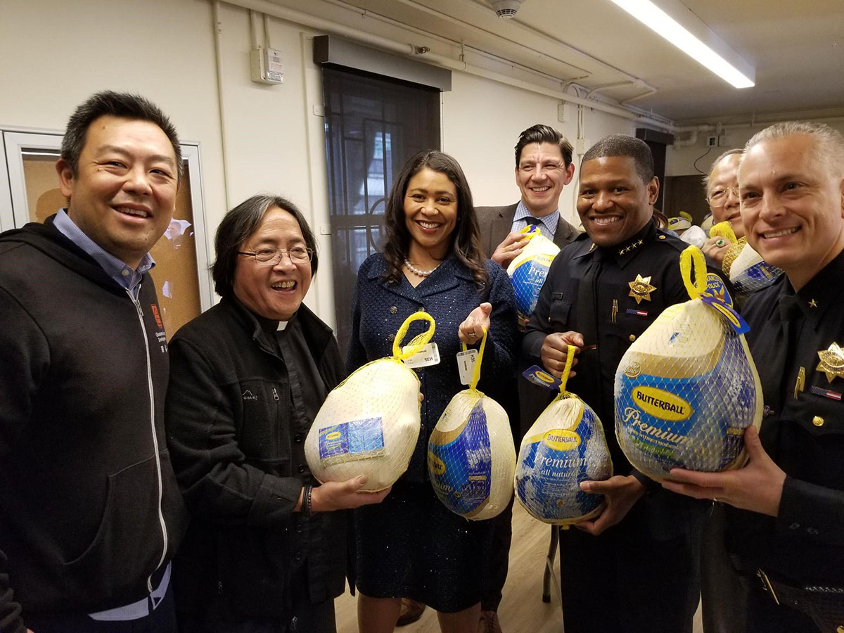 Mayor London Breed and community partners with some of the 4,000 turkeys being distributed to residents in public housing and at non-profit organizations for the 2018 Mayor's Turkey Giveaway.