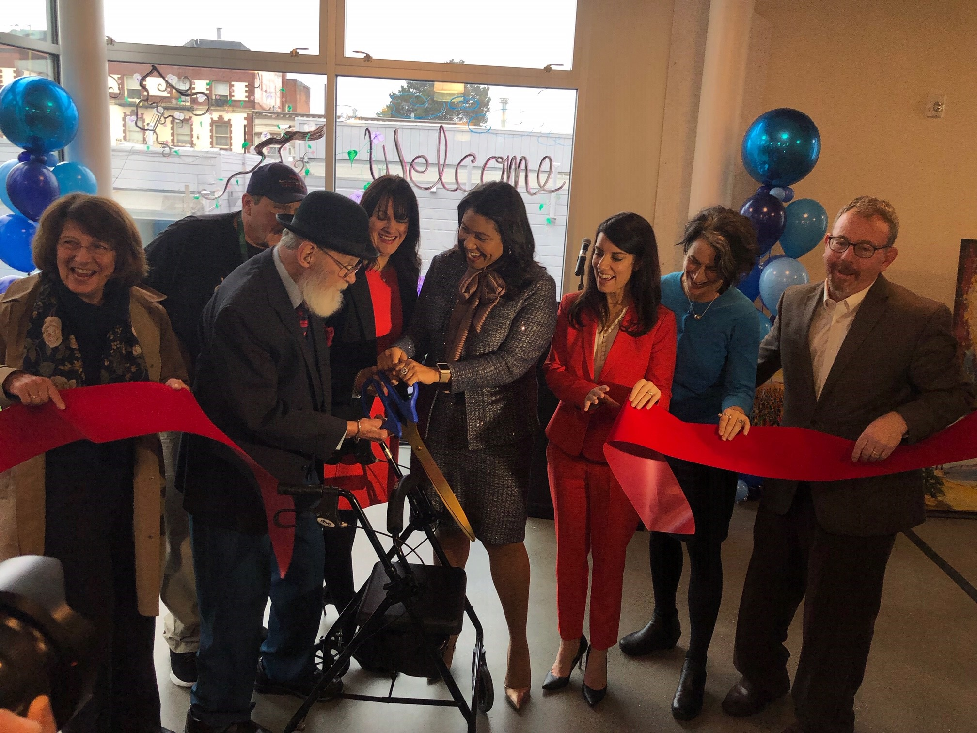Mayor London Breed and community partners celebrate the reopening of affordable housing at JFK Tower and 2698 California