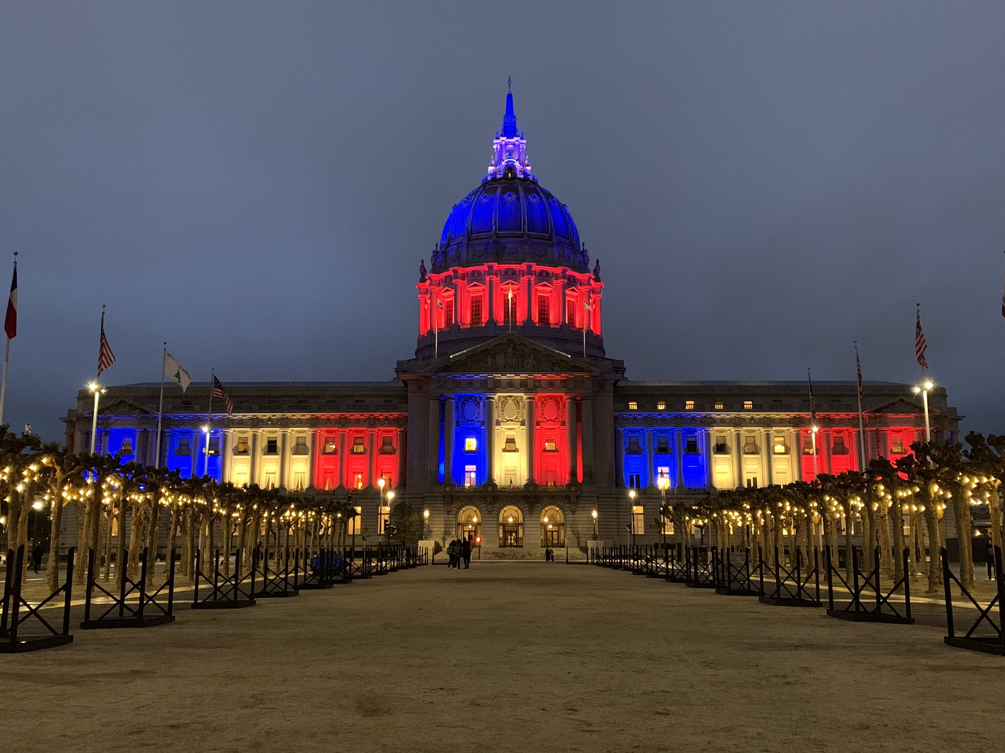City Hall lit in colors of French Flag in solidarity with Notre-Dame de Paris