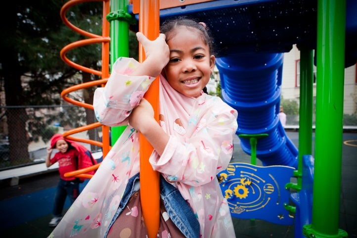 Happy girl on playground - Shared Schoolyards