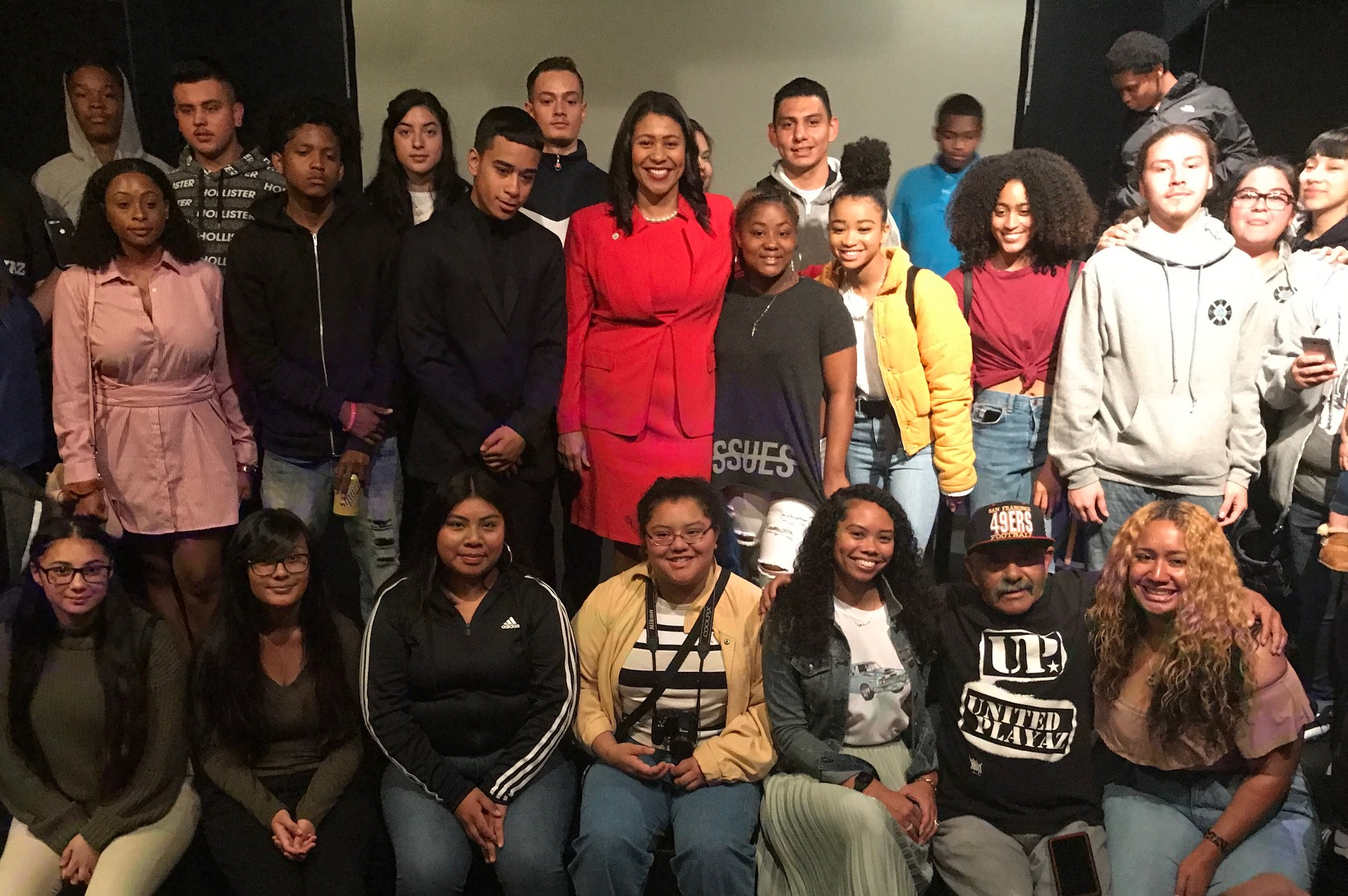 Mayor London Breed with young people from community organizations