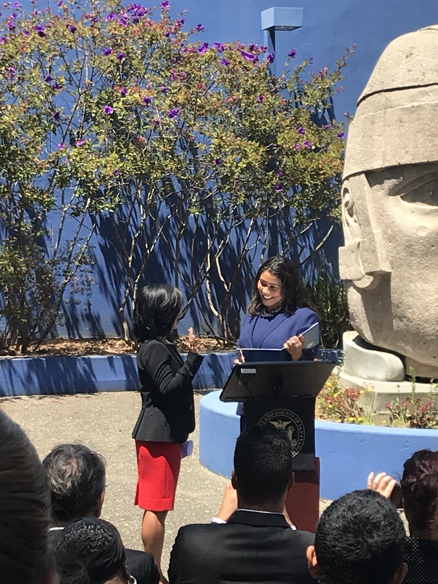 Mayor London Breed administers the oath of office to new CCSF Trustee Ivy Lee at a press conference