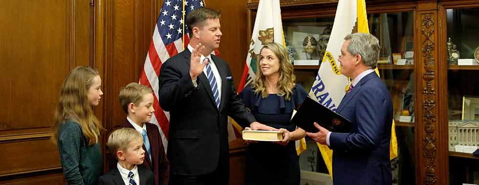 Mayor Farrell being sworn into office with family at his side