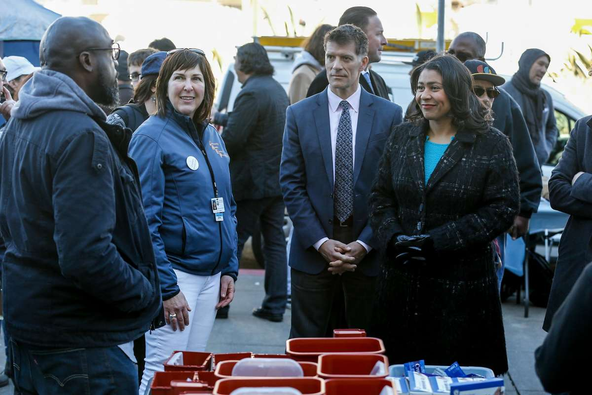 Mayor London Breed with Director Colfax touring a homelessness health fair